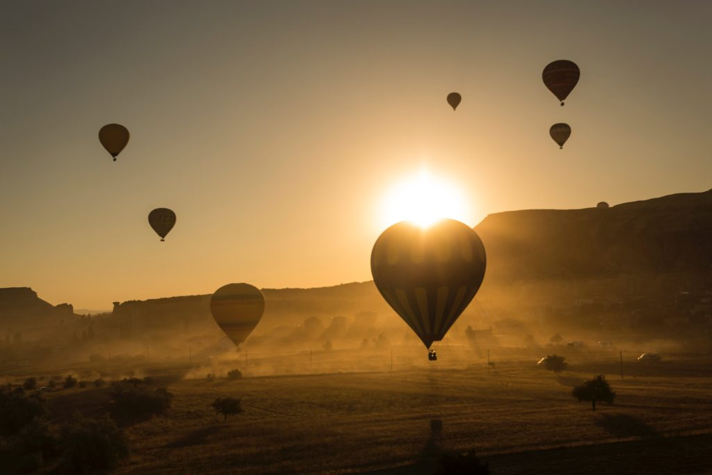 Hot air balloons against sunset